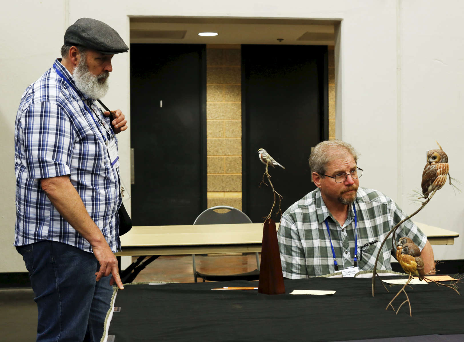 (L-R) Phil Soucy and Dawayne Dewey, mammals judges, look at other entries after judging their categories, during the World Taxidermy & Fish Carving Championships, at the Springfield Expo Center, in Springfield, Missouri on May 1, 2019.