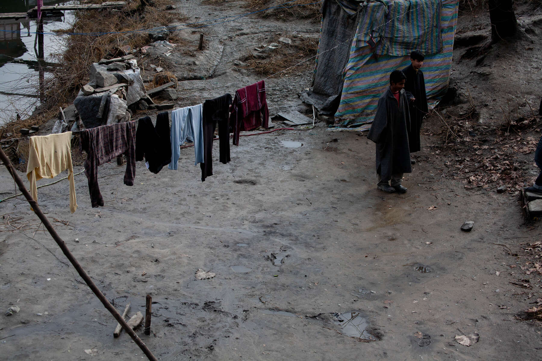 Clothes dry over mud pools. The weight of winter looms in the stillness of days. Kashmir's summer capitol waits for the seasons to pass, while business stalls in it's inability to thrive.
