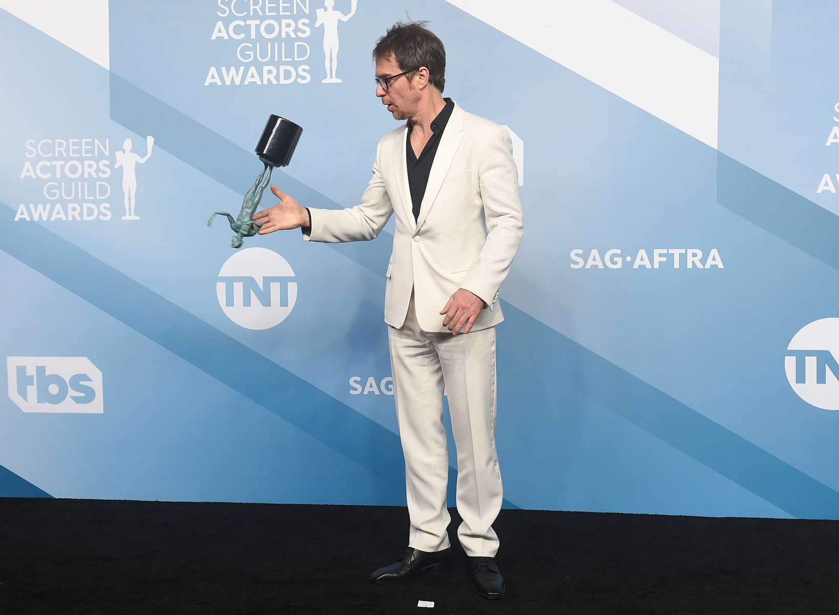 Sam Rockwell flips his award for outstanding performance by a male actor in a television movie or miniseries for {quote}Fosse/Verdon{quote} in the press room at the 26th annual Screen Actors Guild Awards at the Shrine Auditorium & Expo Hall on Sunday, Jan. 19, 2020, in Los Angeles. (Photo by Jordan Strauss/Invision/AP)