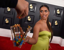 Lilly Singh gives out candy from her purse as she arrives at the 62nd annual Grammy Awards at the Staples Center on Sunday, Jan. 26, 2020, in Los Angeles. (Photo by Jordan Strauss/Invision/AP)