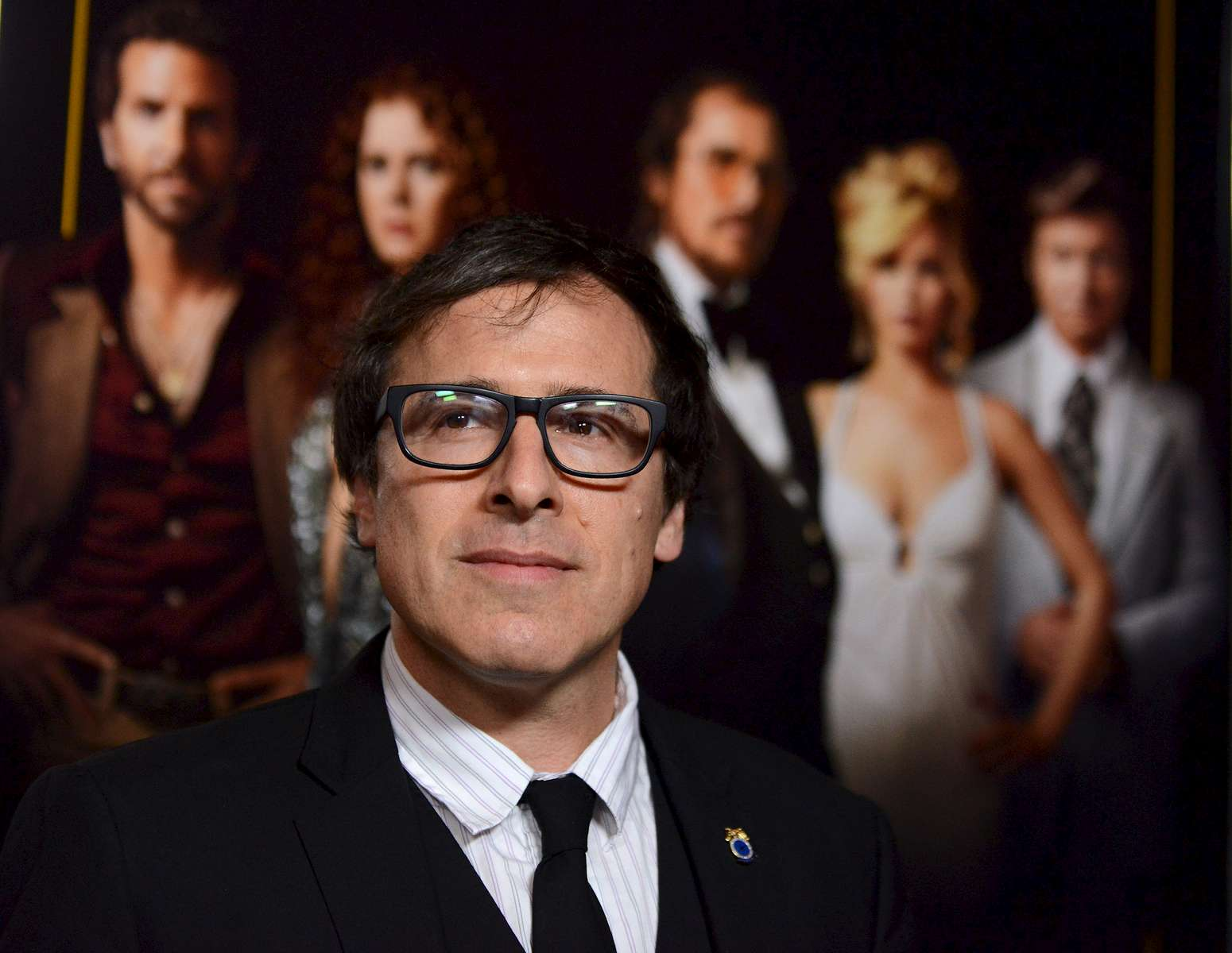 David O. Russell arrives at the Los Angeles special screening of \{quote}American Hustle\{quote} at Directors Guild of America on Tuesday, Dec. 3, 2013 in Los Angeles. (Photo by Jordan Strauss/Invision/AP)