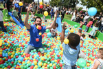 """IMAGE DISTRIBUTED FOR LITTLE TIKES - Brett Tutor from TLC's """"Trading Spaces"""" hosted Little Tikes' 50th anniversary -- the World's Biggest Play Date --  on Saturday, May 18, 2019, in Pasadena, Calif., inspiring parents and kids to play together. Little Tikes is known for such iconic childhood toys as the Turtle Sandbox, Cape Cottage Playhouse™, Jump N Slide Bouncer and Easy Store ™ 3ft Trampoline among many other toys. (Photo by Jordan Strauss/Invision for Little Tikes/AP Images)"""