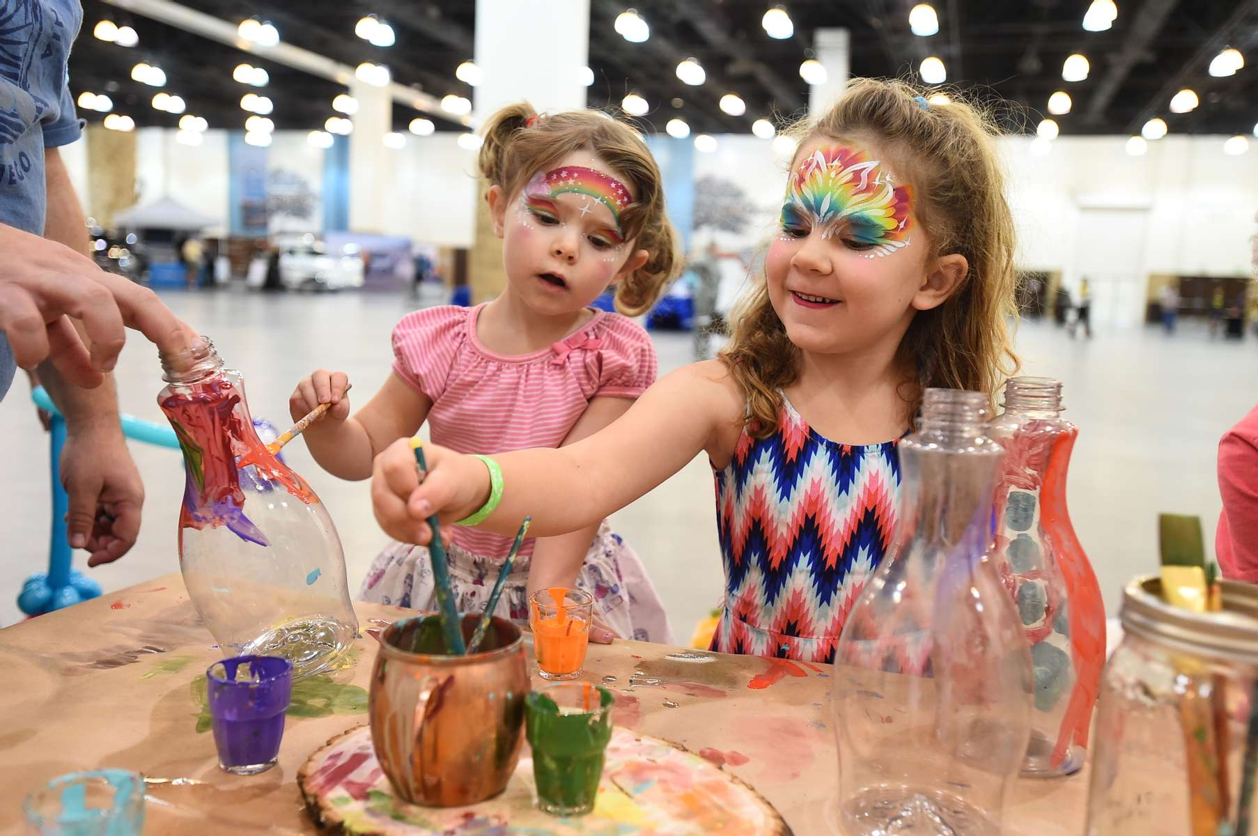 Kids are busy creating vase masterpieces at the Califia craft area at Live On Green on Friday, Dec. 29, 2017, in Pasadena, Calif. (Jordan Strauss/AP Images for HQ)
