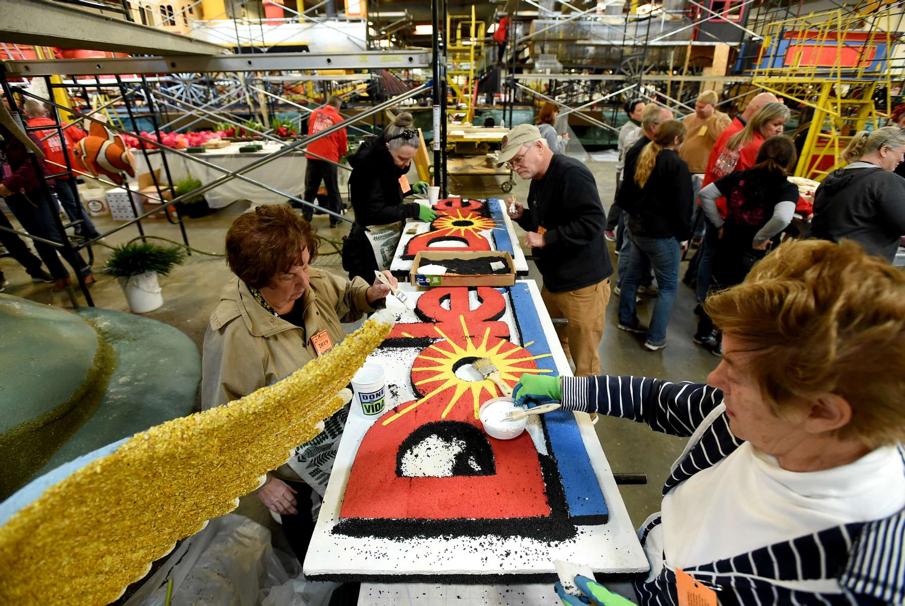 Volunteers apply final touches to the Dole Packaged Foods {quote}Rhythm of Paradise{quote} Rose Parade float during Decorating Week at Fiesta Parade Floats on Saturday, Dec. 29, 2018 in Irwindale, Calif. (Jordan Strauss/AP Images for Dole Packaged Foods)