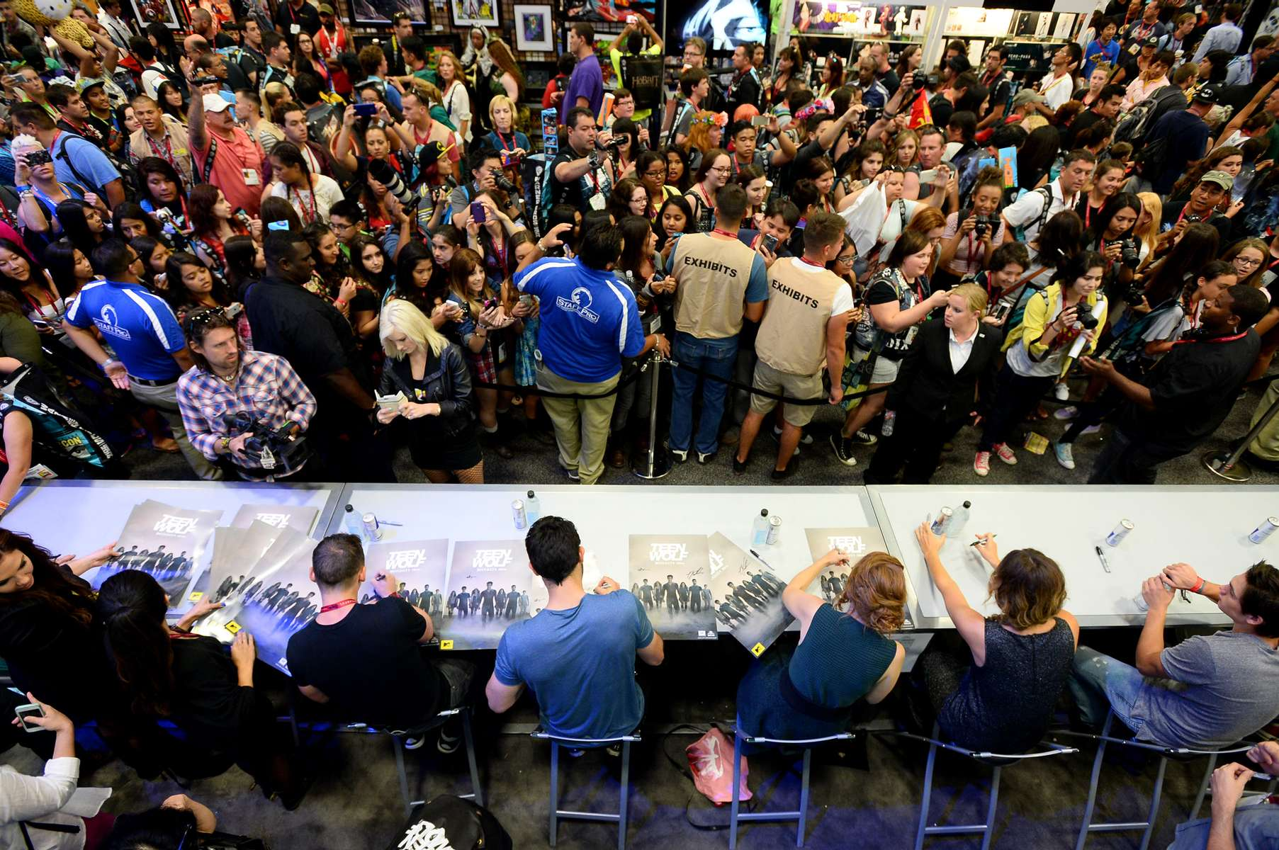 The cast of {quote}Teen Wolf{quote} signs autographs during Comic Con on Friday, July 25, 2014 in San Diego. (Photo by Jordan Strauss/Invision for MTV/AP Images)