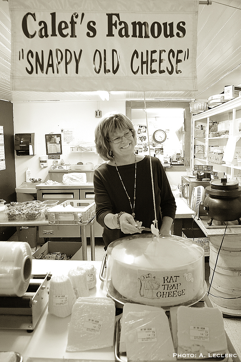 Aaron Leclerc/Staff photographerOwner of Calef's Country Store in Barrington,   ,  prepares to cut some of the store's famous 'Snappy Old Cheese' recently.