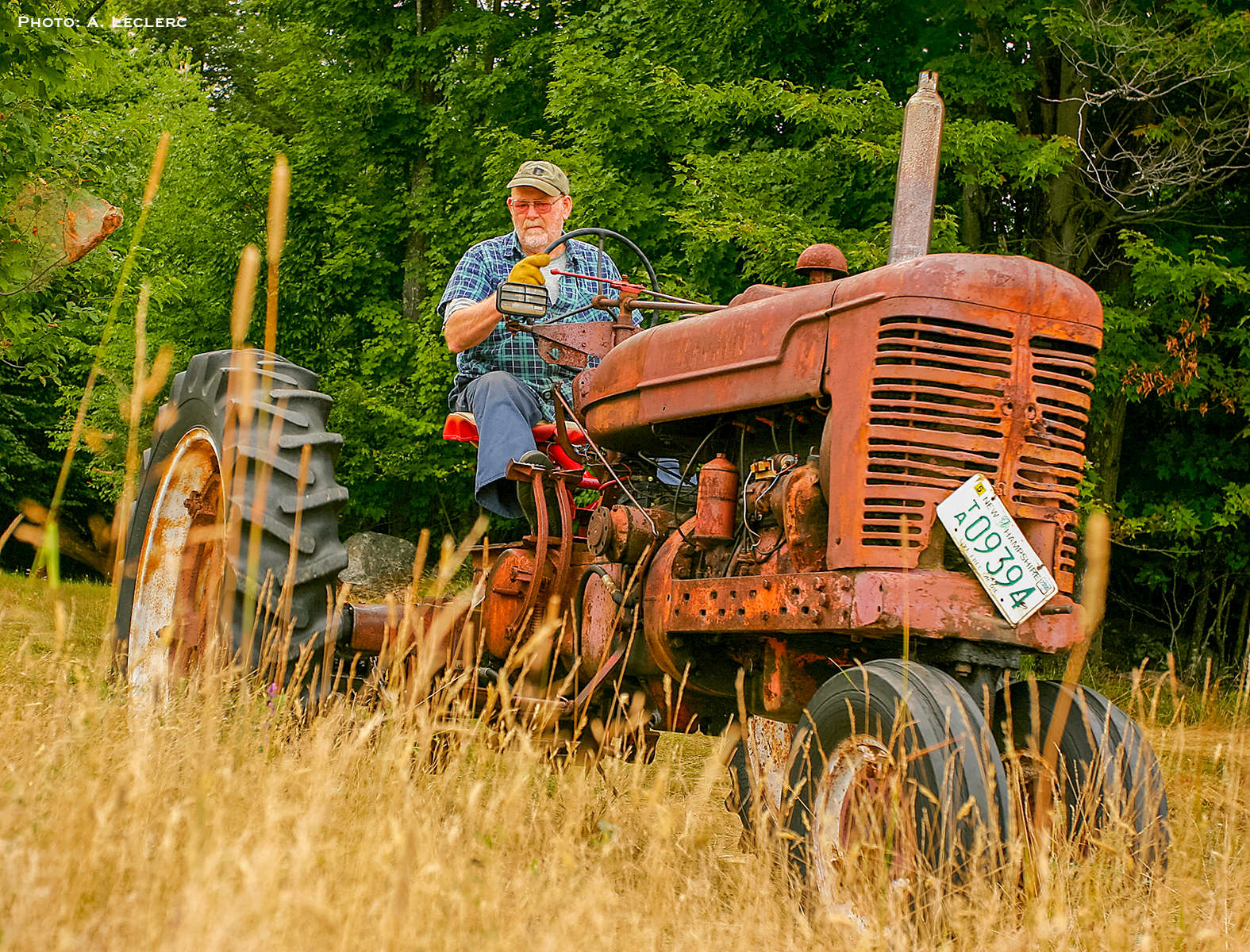 Aaron Leclerc/Staff photographer'Red' Goodwin of Farmington helps a neighbor out by mowing a hay field at the Bean-Demeritt Farm Monday afternoon.