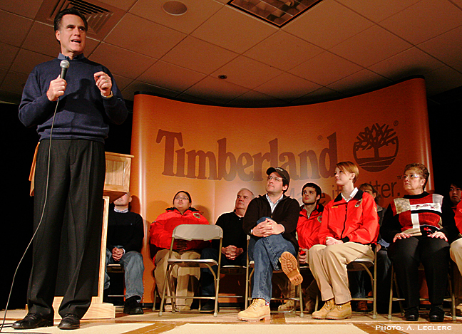 Aaron Leclerc/Staff photographerAs all presidential candidates hustle to get their message out before Tuesday's Primary, Republican Mitt Romney speaks to a crowded room at Timberland in Stratham, Monday.