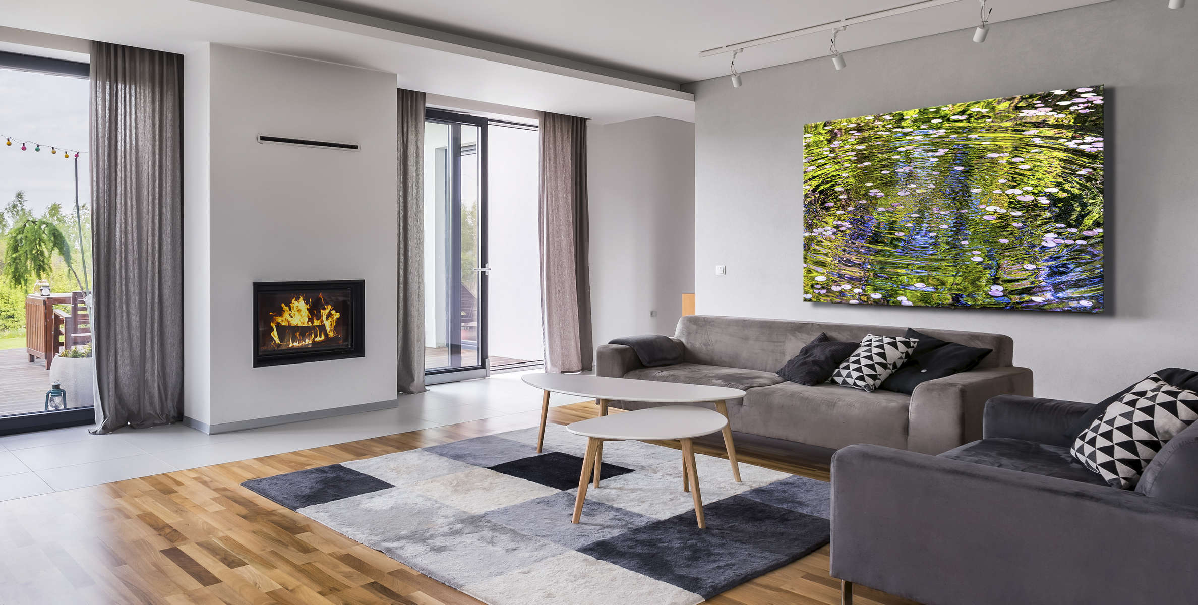 Spacious living room with floor panels, sofa and armchair