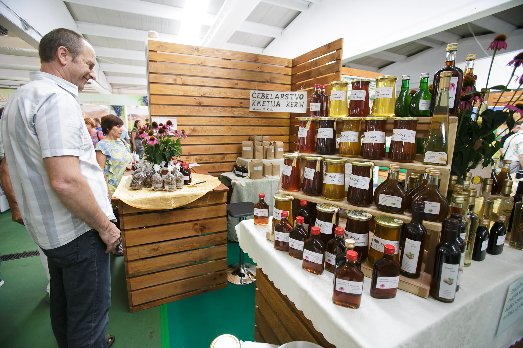 A man admires the selection of Slovenian honey at the 53rd agricultural fair Agra in Gornja Radgona, Slovenia, Aug. 22, 2015.