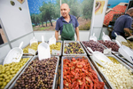 A man sells numerouse types of olives at the 53rd agricultural fair Agra in Gornja Radgona, Slovenia, Aug. 22, 2015.