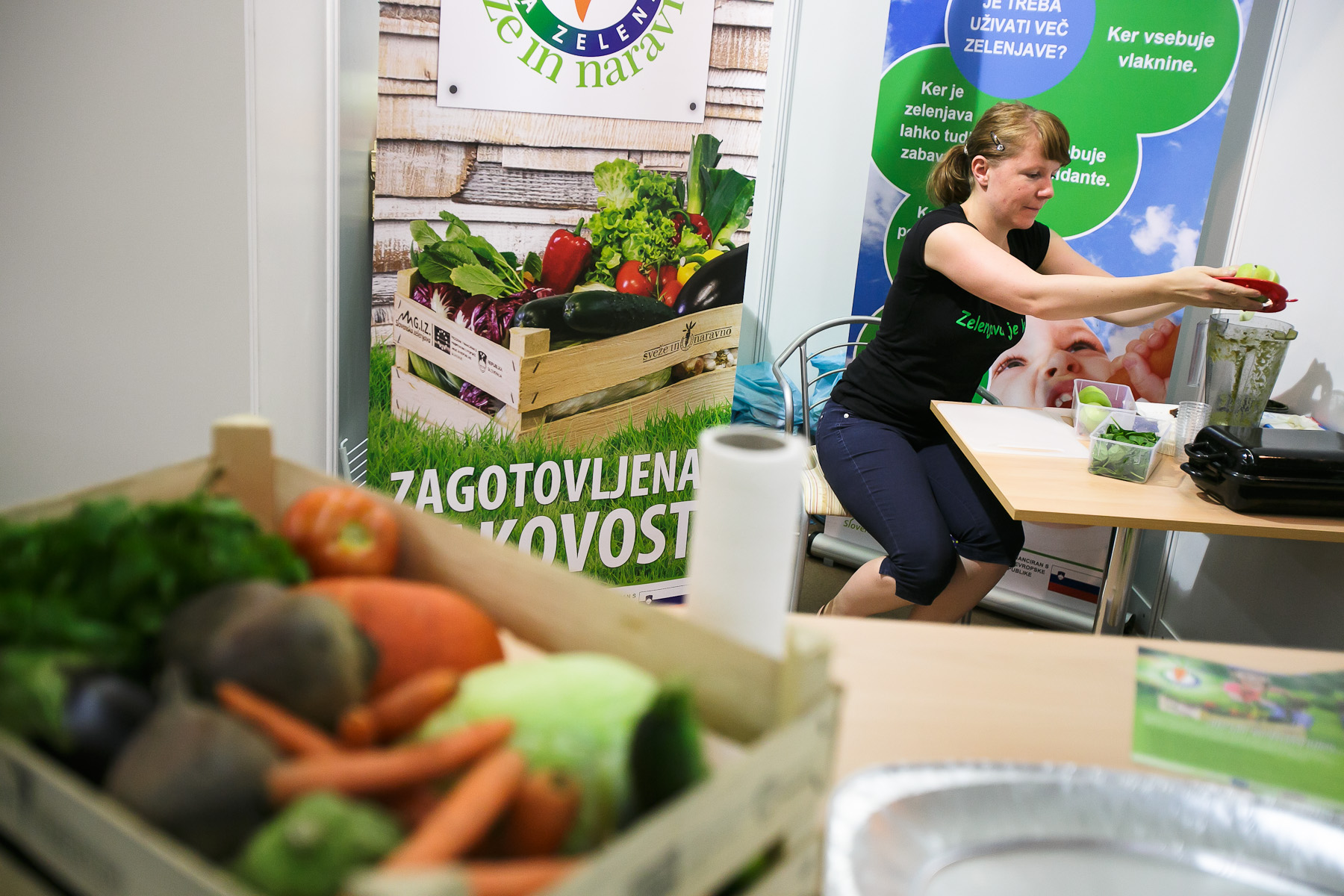 A woman makes a smoothie at the 53rd agricultural fair Agra in Gornja Radgona, Slovenia, Aug. 22, 2015.