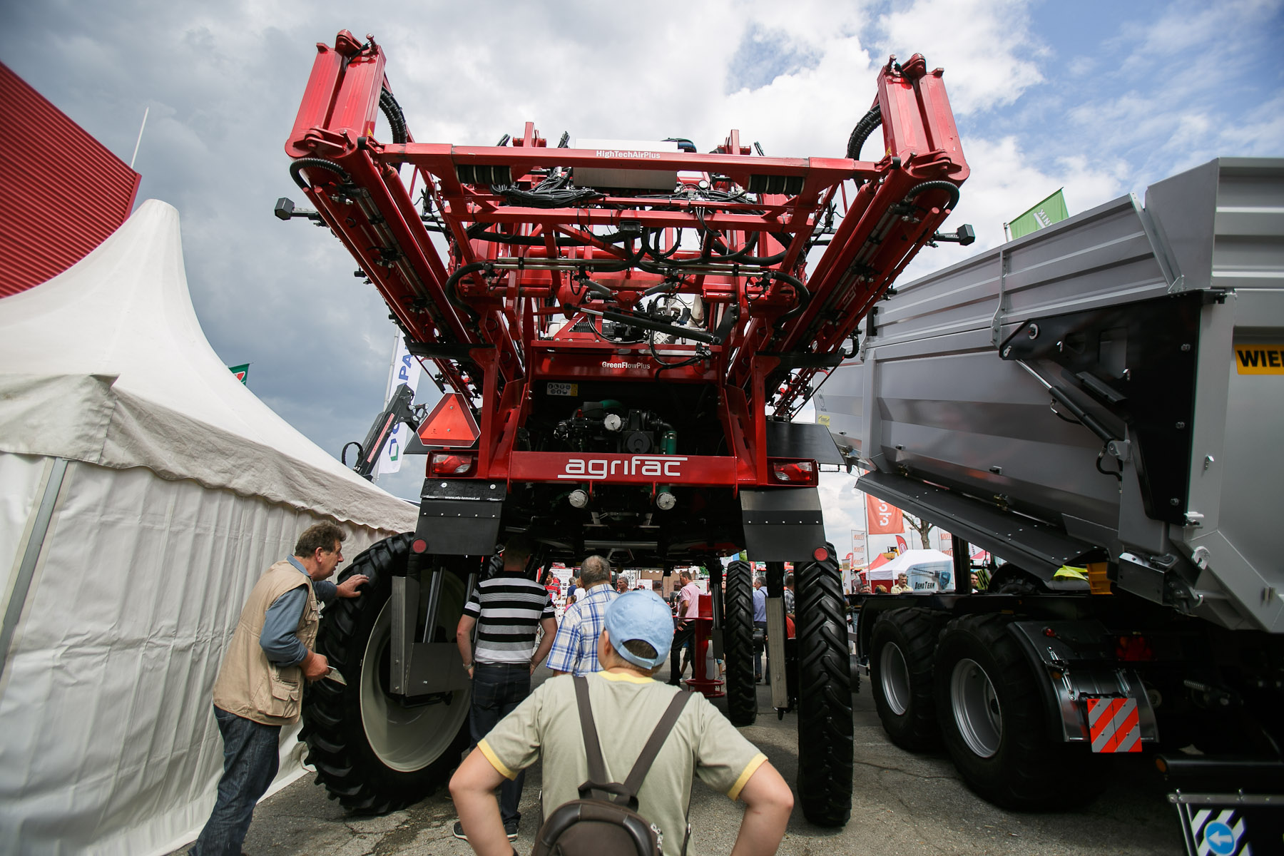 People admire heavy machinery at the 53rd agricultural fair Agra in Gornja Radgona, Slovenia, Aug. 22, 2015.