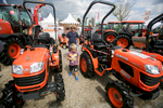 People walk among farm vehicles at the 53rd agricultural fair Agra in Gornja Radgona, Slovenia, Aug. 22, 2015.