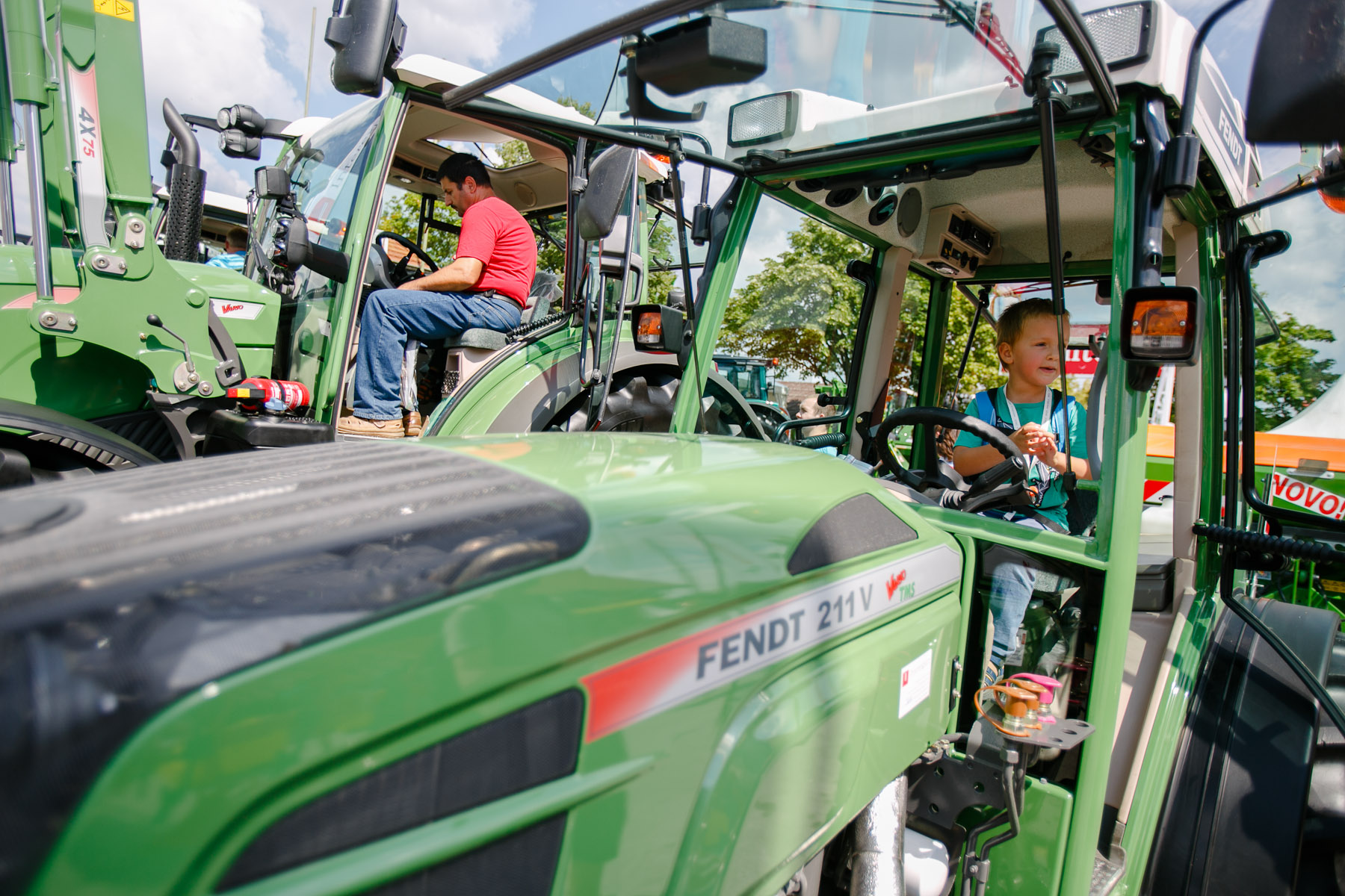 Visitors inspect the exhibited tractors at the 53rd agricultural fair Agra in Gornja Radgona, Slovenia, Aug. 22, 2015.