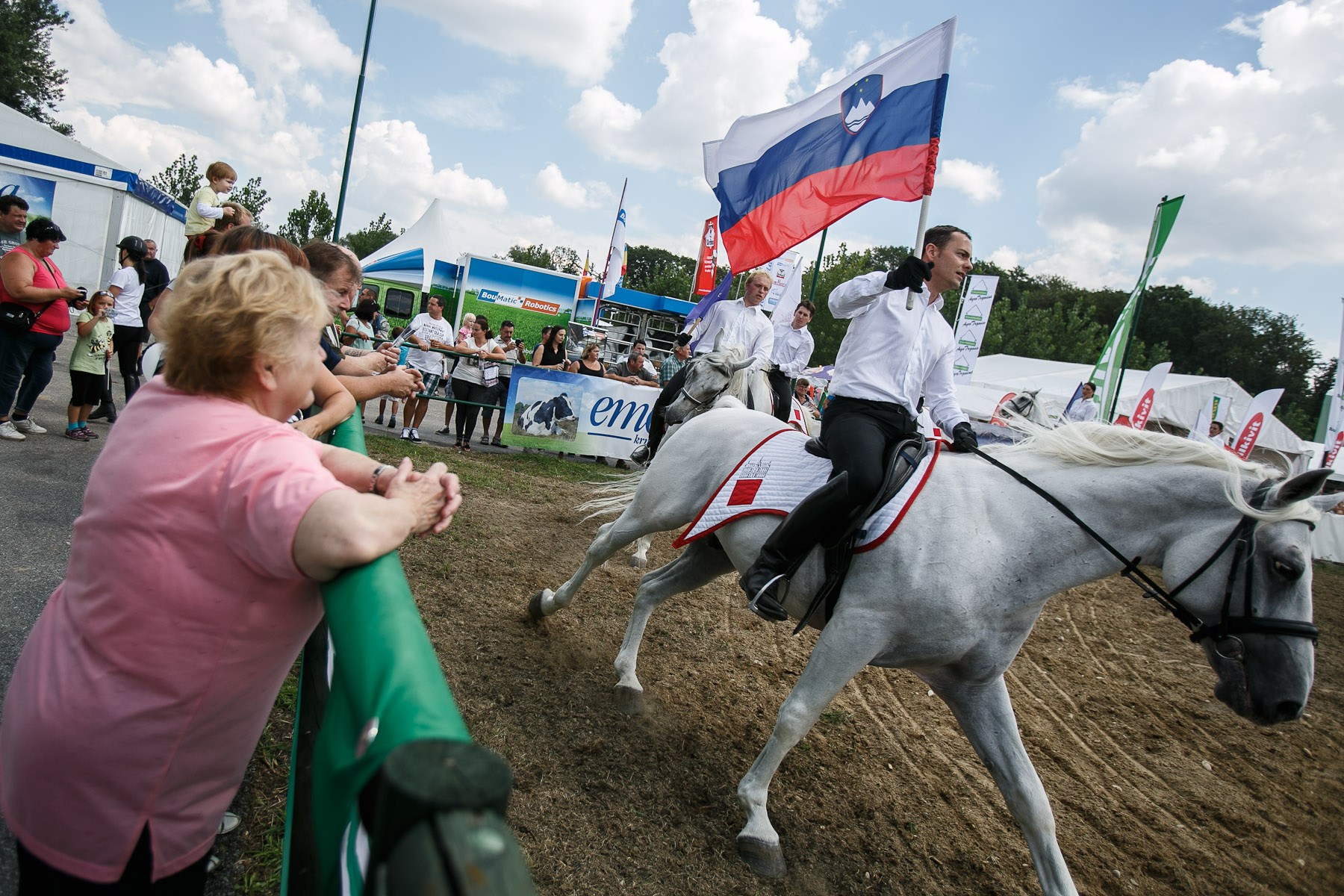 People watch the lipizzaner horse show at the 53rd agricultural fair Agra in Gornja Radgona, Slovenia, Aug. 22, 2015.