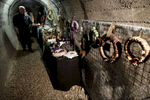 Visitors observe the advent wreaths exhibition in the underground tunnels in Kranj, Slovenia.