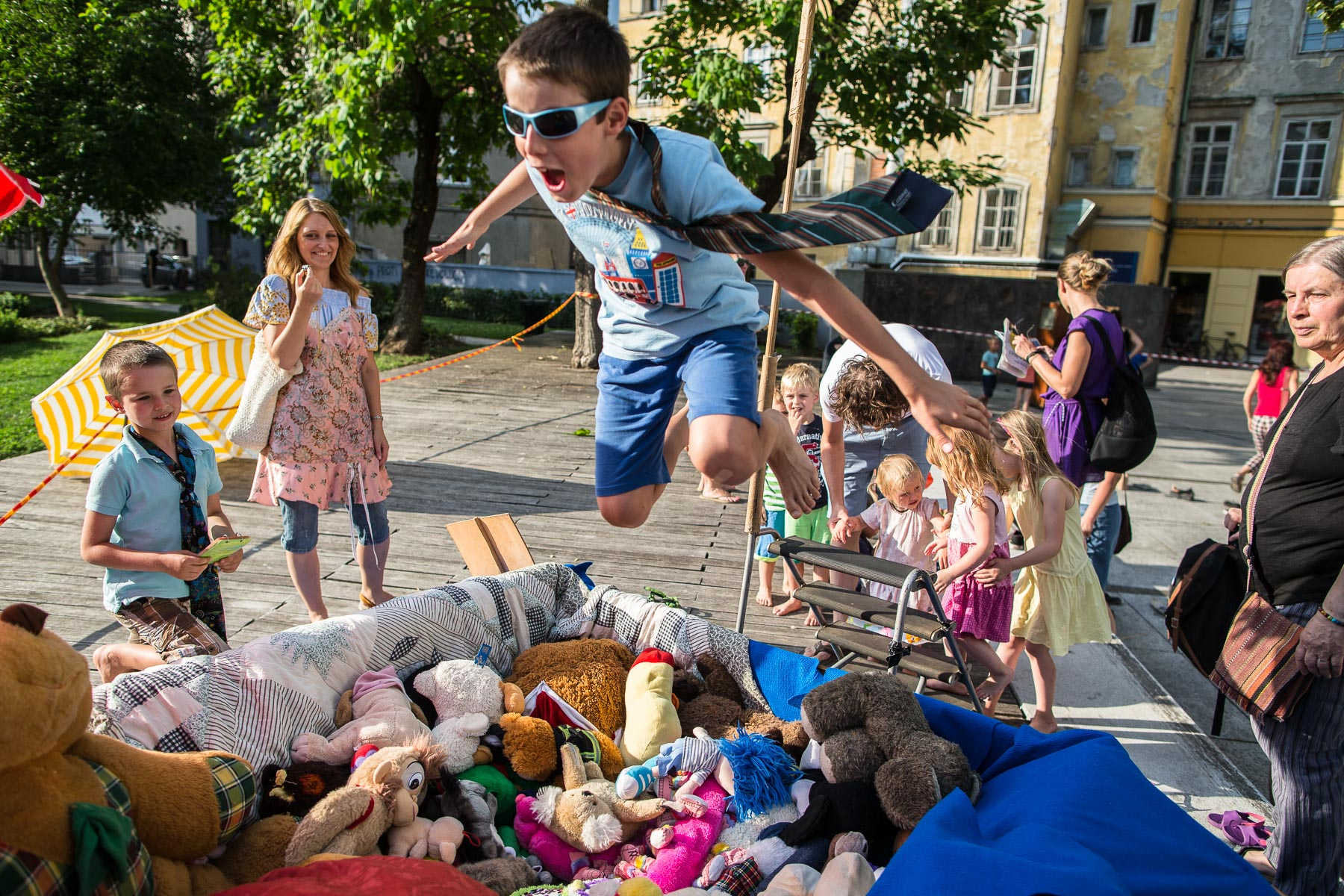 A boy jumps into a pool of plush toys at the 20th annual Ana Desetnica International Street Theatre Festival in Ljubljana, Slovenia, July 5 2017.