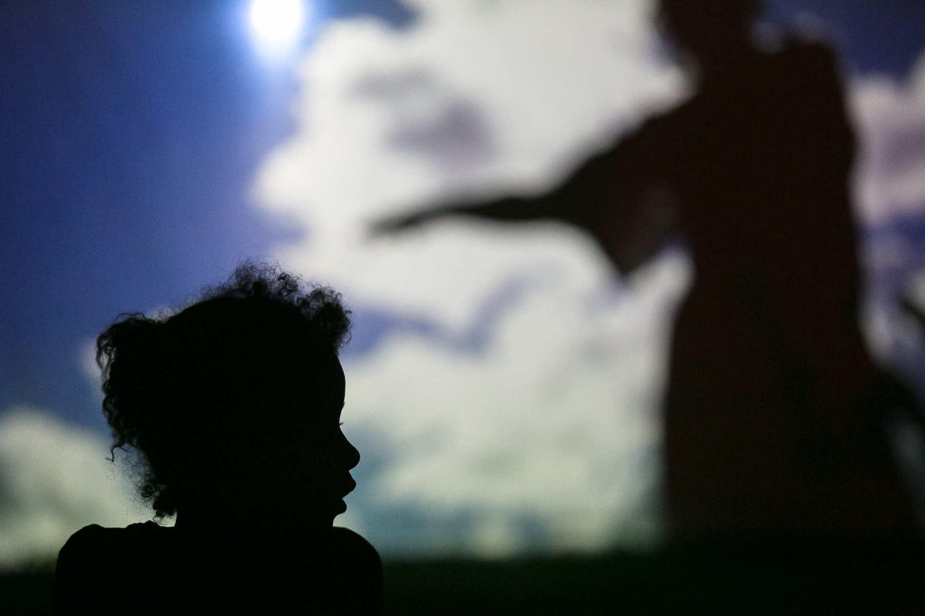 A girl watches a shadow performance by Dolina odmeva (SLO) street theatre group during the 20th annual Ana Desetnica International Street Theatre Festival in Ljubljana, Slovenia, July 6, 2017.