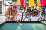 An elderly woman plays at a playground set up by Drago Zadnikar (SLO) at the 20th annual Ana Desetnica Intl. Street Theatre Festival in Ljubljana, July 7, 2017.