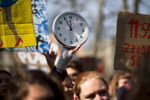 A protester holds up a a doomsday clock during a Youth Climate Strike in Ljubljana, Slovenia, on March 15. Around five thousand students protest inaction on climate change in Ljubljana, Slovenia,  as part of a global Youth Climate Strike on Friday, March 15. (Xinhua/Luka Dakskobler)