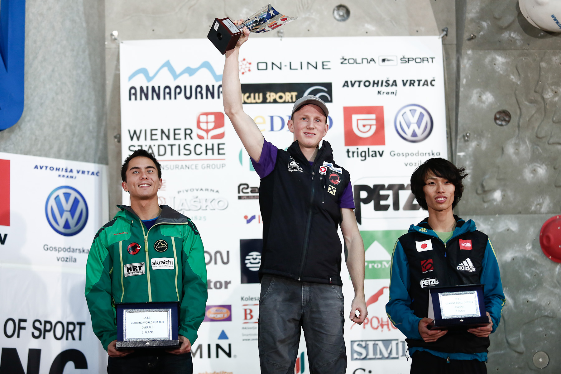 Sean McColl (CAN), Jakob Schubert (AUT) and Sachi Amma (JPN) on the podium for overal results in the IFSC climbing world cup in Kranj, Slovenia, on Nov 18, 2012.