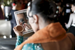 A dancers fixes her makeup before competing at the 2013 Ljubljana Open dancing competition in Ljubljana, Slovenia.