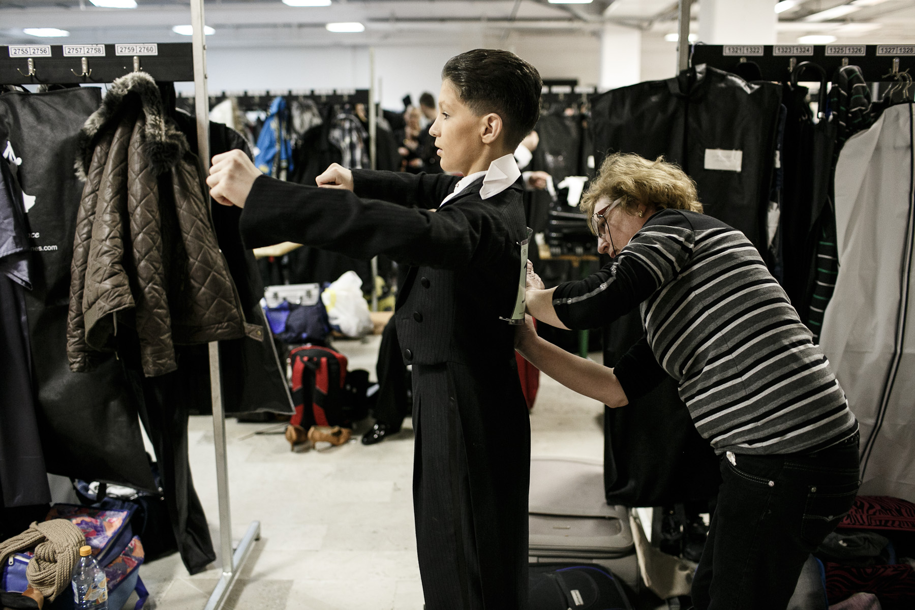 A young dancer has his starting number fitted in the dressing room of the 2013 Ljubljana Open dancing competition in Ljubljana, Slovenia.