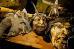 Hand-carved wooden Krampus masks rest in the dressing tent before the Krampus gathering in Goricane, Slovenia, Nov. 21, 2015. In Central European alpine folklore, Krampus is a demonic creature traditionally following St. Nicholas and angels on the evening of December 5. It pries on children who were not good during the year.
