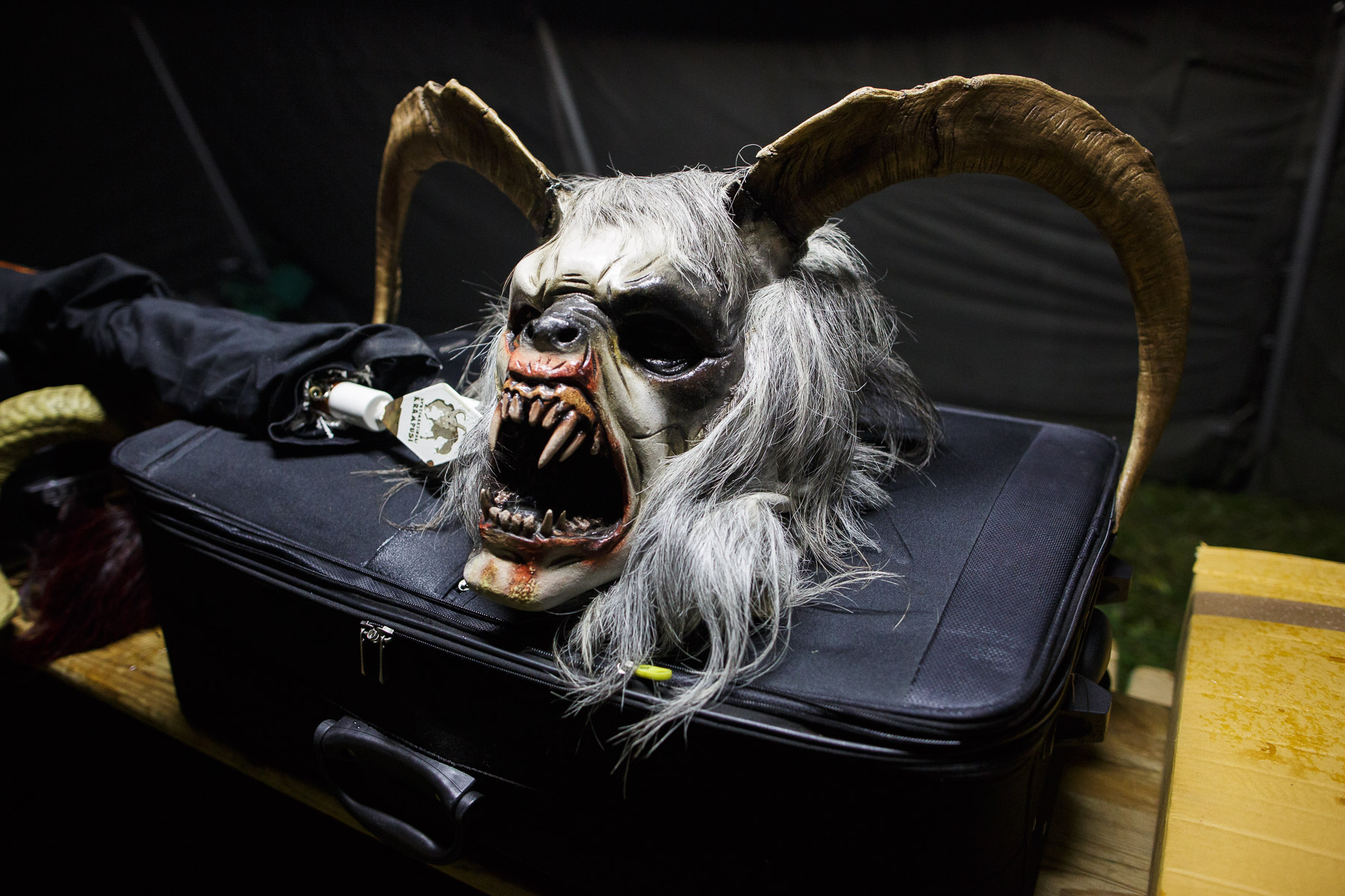 A hand-carved wooden Krampus mask rests in the dressing tent before the Krampus gathering in Goricane, Slovenia, Nov. 21, 2015. In Central European alpine folklore, Krampus is a demonic creature traditionally following St. Nicholas and angels on the evening of December 5. It pries on children who were not good during the year.