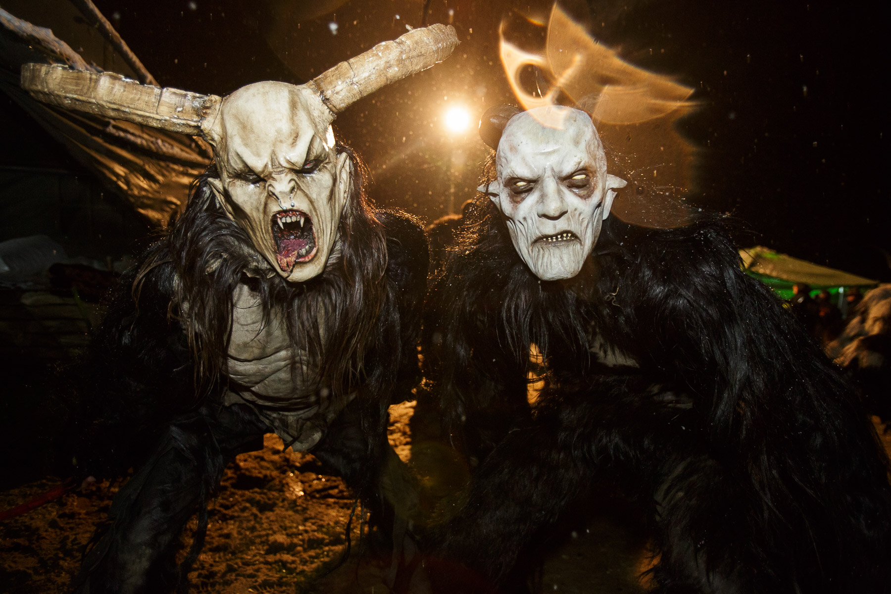 Participants dressed as Krampus creatures during the Krampus gathering in Goricane, Slovenia, Nov. 21, 2015. In Central European alpine folklore, Krampus is a demonic creature traditionally following St. Nicholas and angels on the evening of December 5. It pries on children who were not good during the year.