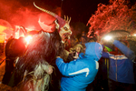 A participant dressed as the Krampus creature scares onlookers during the Krampus gathering in Goricane, Slovenia, Nov. 21, 2015. In Central European alpine folklore, Krampus is a demonic creature traditionally following St. Nicholas and angels on the evening of December 5. It pries on children who were not good during the year.
