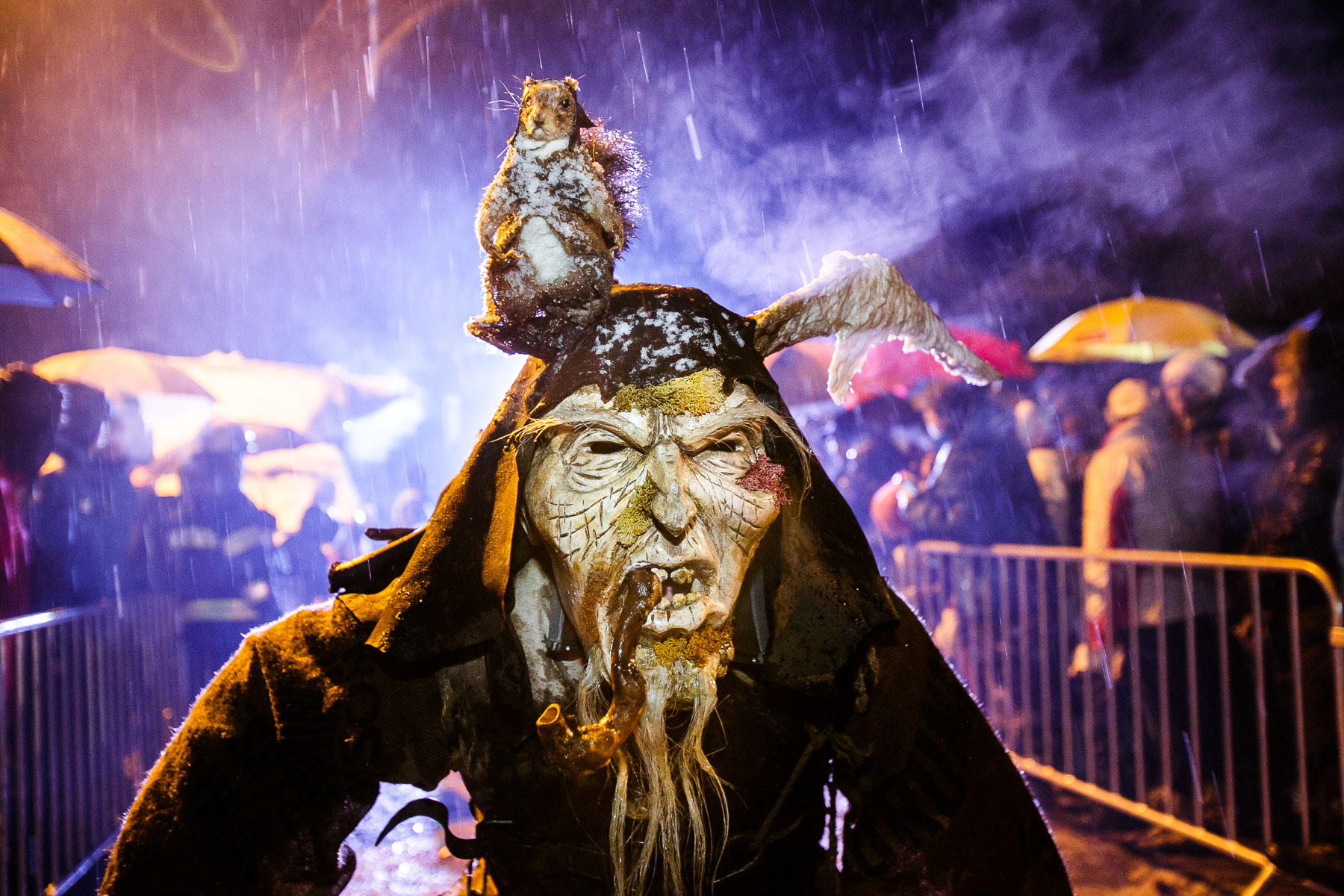 A participant dressed as a Krampus creature walks the street during the Krampus gathering in Goricane, Slovenia, Nov. 21, 2015. In Central European alpine folklore, Krampus is a demonic creature traditionally following St. Nicholas and angels on the evening of December 5. It pries on children who were not good during the year.