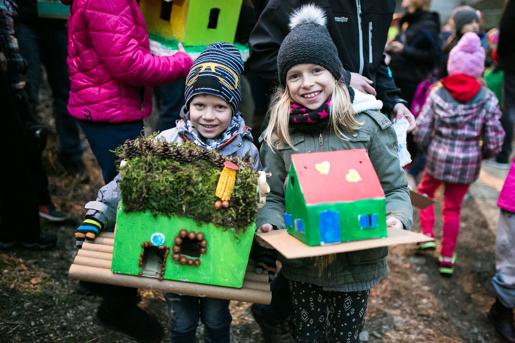 Children pose with their model houses or {quote}gregorcki{quote} during a traditional event called Light in the water, in which model houses and other objects are lit with candles and thrown in the water to symbolize the coming of spring, in Trzic, Slovenia, on March 11, 2016, the eve before St. Gregory's Day that was once the first day of spring.