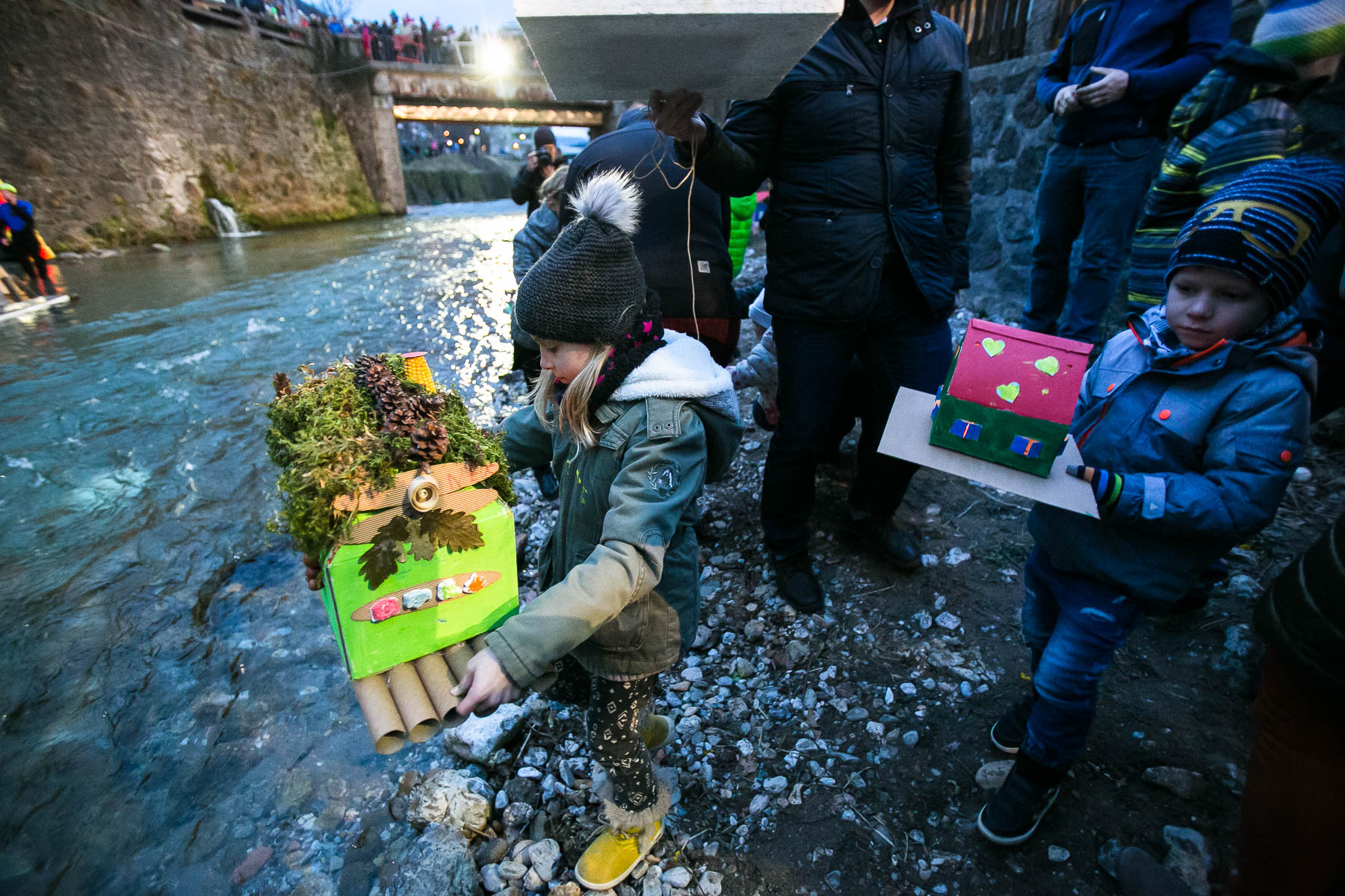 Children carry model houses or {quote}gregorcki{quote} to the water during a traditional event called Light in the water, in which model houses and other objects are lit with candles and thrown in the water to symbolize the coming of spring, in Trzic, Slovenia, on March 11, 2016, the eve before St. Gregory's Day that was once the first day of spring.