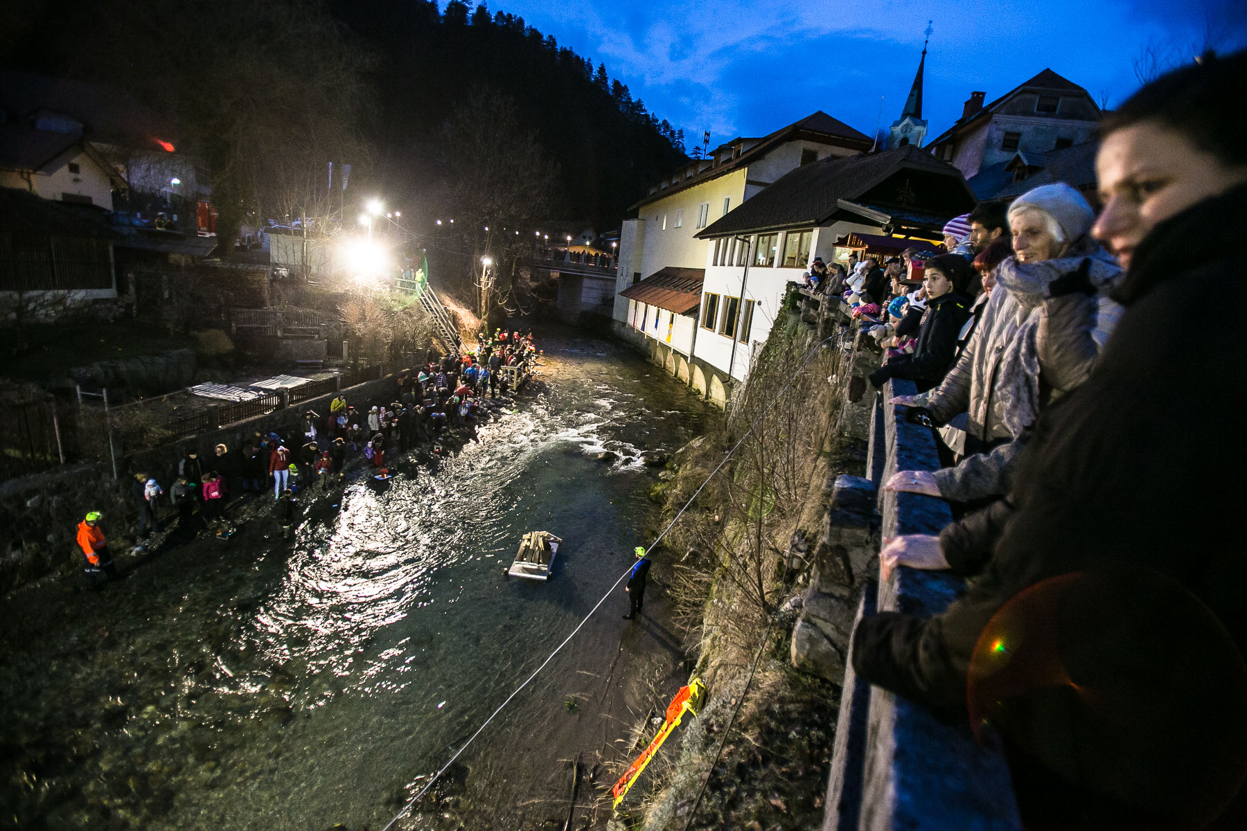 People watch the release of hundreds of model houses or {quote}gregorcki{quote} down the river during a traditional event called Light in the water, in which model houses and other objects are lit with candles and thrown in the water to symbolize the coming of spring, in Trzic, Slovenia, on March 11, 2016, the eve before St. Gregory's Day that was once the first day of spring.