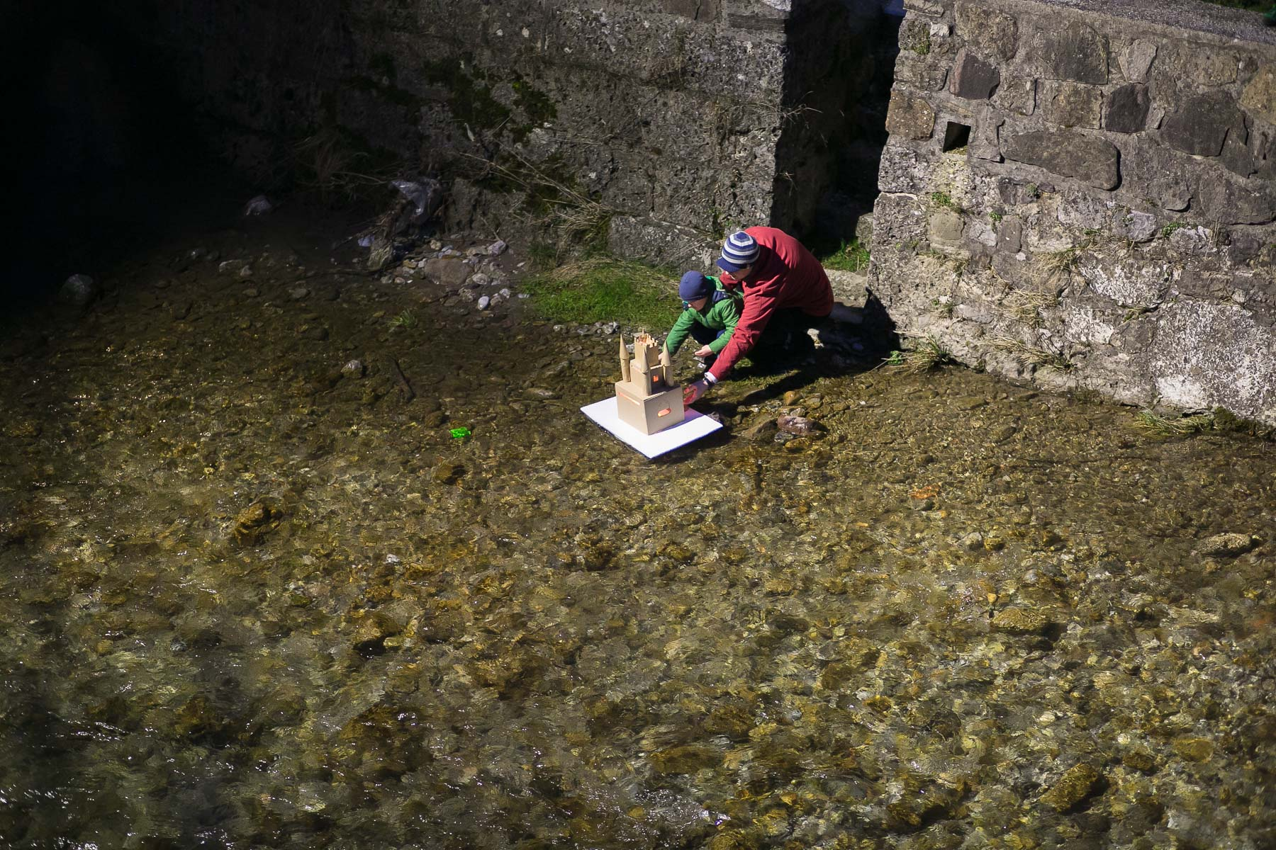 A man and a boy release their model house or {quote}gregorcek{quote} down the river during a traditional event called Light in the water, in which model houses and other objects are lit with candles and thrown in the water to symbolize the coming of spring, in Trzic, Slovenia, on March 11, 2016, the eve before St. Gregory's Day that was once the first day of spring.