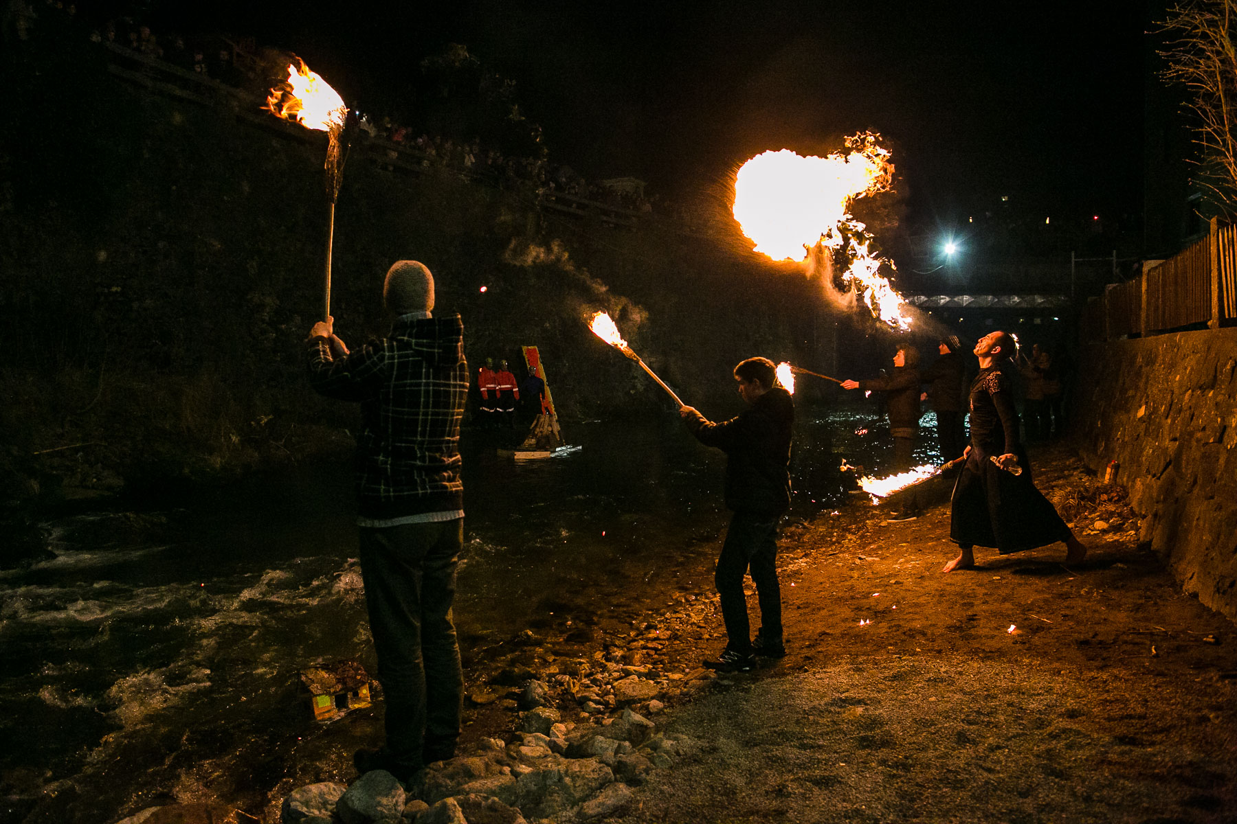 Fire handlers perform during a traditional event called Light in the water, in which model houses and other objects, the so called {quote}gregorcki{quote} are lit with candles and thrown in the water to symbolize the coming of spring, in Trzic, Slovenia, on March 11, 2016, the eve before St. Gregory's Day that was once the first day of spring.
