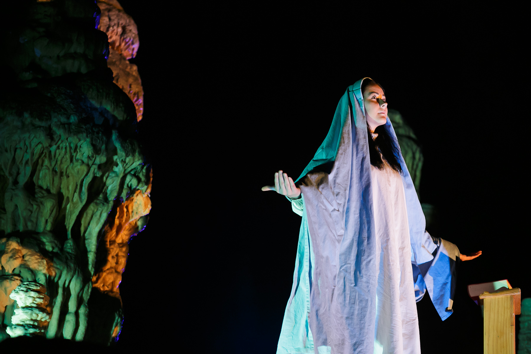 An actress playing Mary performs during the world's largest live Nativity scene in a cave, staged in the Postojna Cave in Slovenia, Dec. 25, 2015.