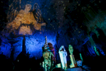 Actors perform a biblical scene during the world's largest live Nativity scene in a cave, staged in the world-famous Postojna Cave in Slovenia, Dec. 25, 2015.