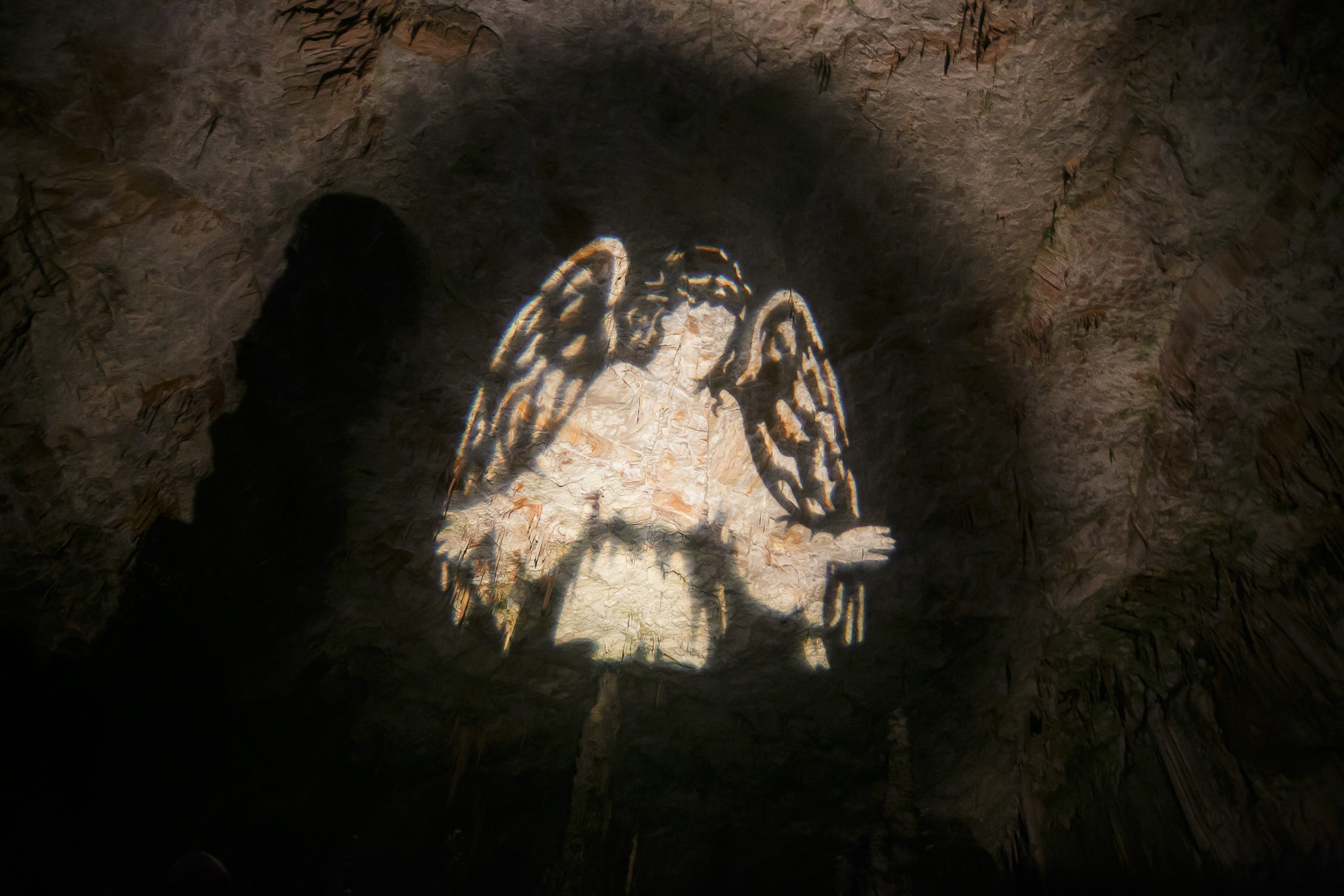 An angel is projected onto a cave ceiling during the world's largest live Nativity scene in a cave, staged in the world-famous Postojna Cave in Slovenia, Dec. 25, 2015.