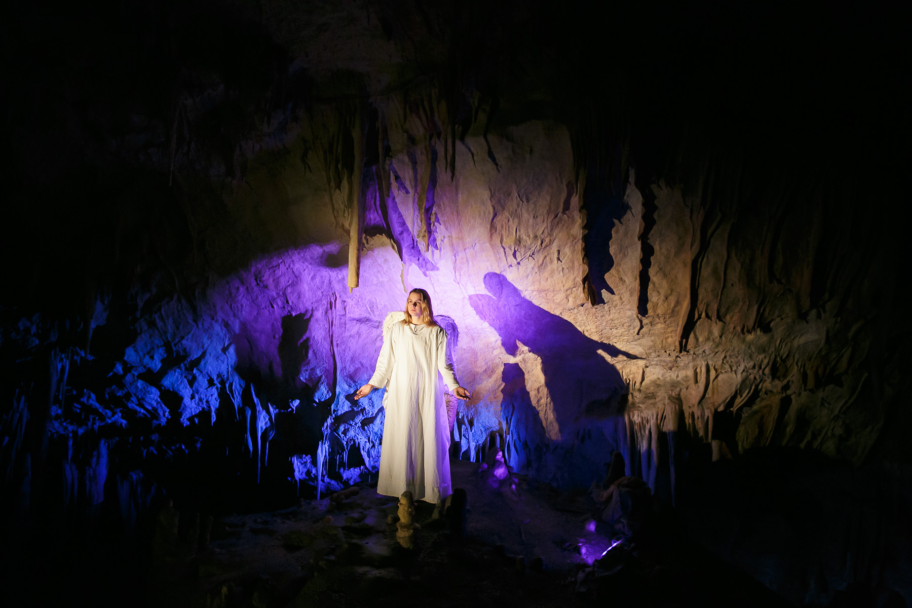 A performer represents an angel during the world's largest live Nativity scene in a cave, staged in the world-famous Postojna Cave in Slovenia, Dec. 25, 2015.