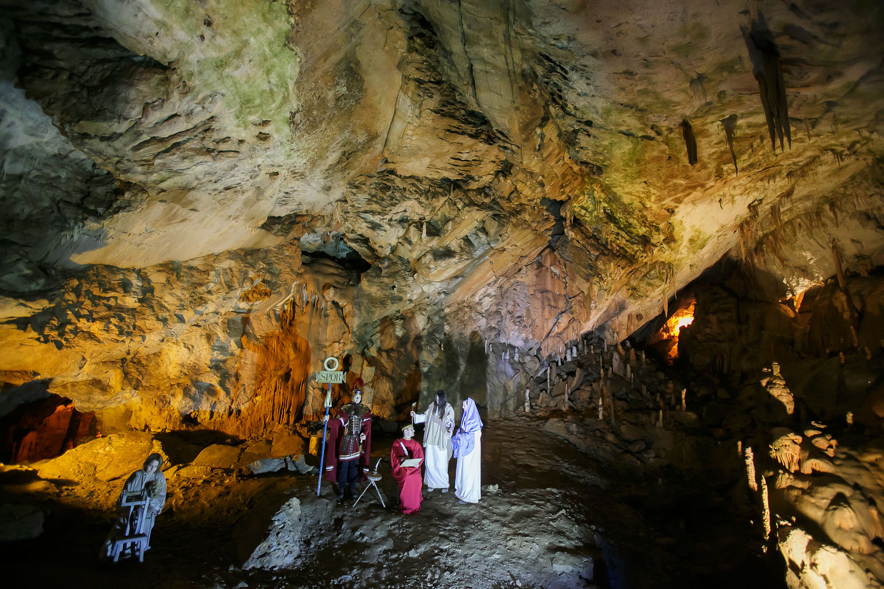 Actors perform in a biblical scene of the census during the world's largest live Nativity scene in a cave, staged in the world-famous Postojna Cave in Slovenia, Dec. 25, 2015.