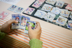 A visitor plays anime cards during the 4th Makkon, the largest Slovenian anime event, in Ljubljana, Slovenia, Dec. 12, 2015.