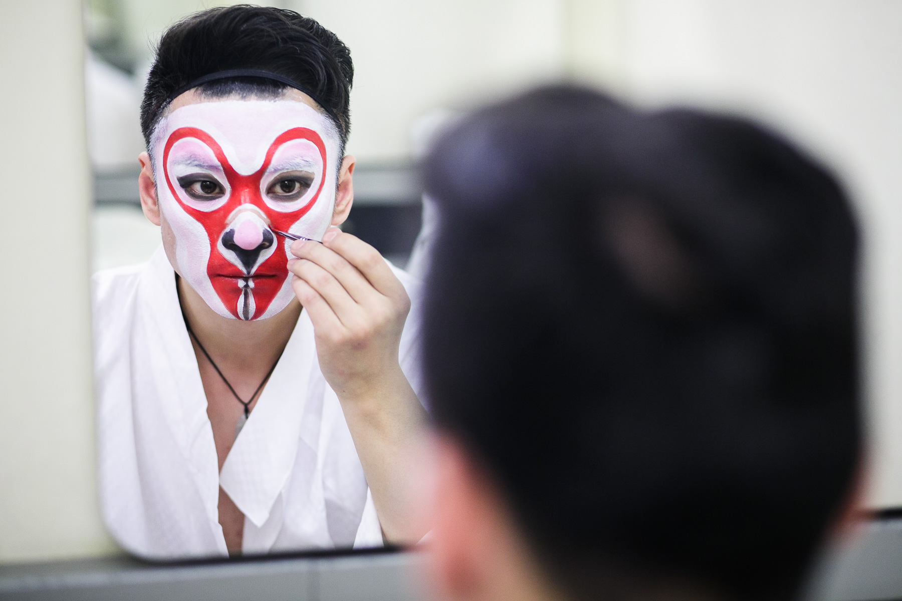 Wang Lu who plays the Monkey King puts on makeup before the China National Peking Opera Company performance of the Monkey King in Cankarjev dom Culture and Congress Center in Ljubljana, Slovenia, Dec. 31, 2015.