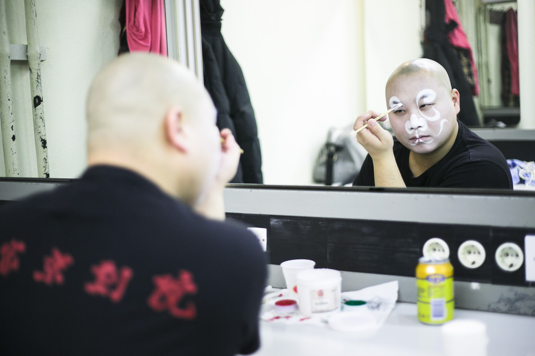 Shi Yan puts on makeup before the China National Peking Opera Company performance of the Monkey King in Cankarjev dom Culture and Congress Center in Ljubljana, Slovenia, Dec. 31, 2015.