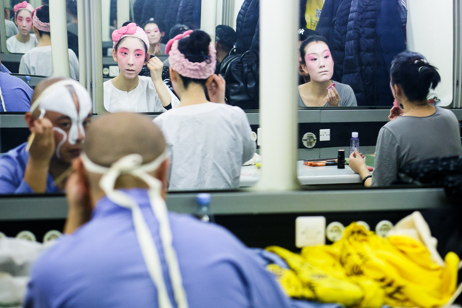 Actors put on makeup before the China National Peking Opera Company performance of the Monkey King in Cankarjev dom Culture and Congress Center in Ljubljana, Slovenia, Dec. 31, 2015.