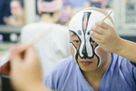 Zhao Long Ji puts on makeup before the China National Peking Opera Company performance of the Monkey King in Cankarjev dom Culture and Congress Center in Ljubljana, Slovenia, Dec. 31, 2015.