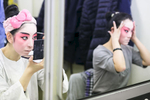 Jia Peng Fei and Bai Weichen put on makeup before the China National Peking Opera Company performance of the Monkey King in Cankarjev dom Culture and Congress Center in Ljubljana, Slovenia, Dec. 31, 2015.