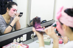 Bai Weichen puts on makeup before the China National Peking Opera Company performance of the Monkey King in Cankarjev dom Culture and Congress Center in Ljubljana, Slovenia, Dec. 31, 2015.